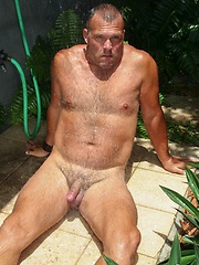 King-sized Brock Hart cools down in an outdoor shower