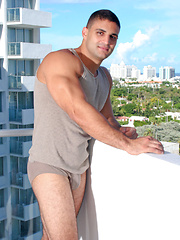 Tall, muscular hunk Latino Ronnie invites you to his hotel room