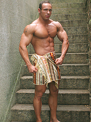 Solid muscleman Vinnie de Angelo posing outdoor