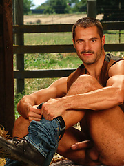 Gay cowboy relaxing at the hayloft