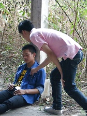 Hot fuck scene between these 2 gorgeous Asian boys in the outdoors