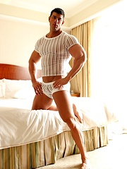 Super handsome hunk dressed in tight shirt and pants