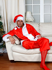 Santa Marcello is dressed in a cheeky outfit and playing with his huge cock